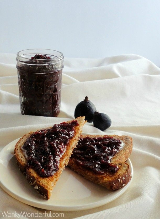 toast with smear of fig jam, jar of jam in the background
