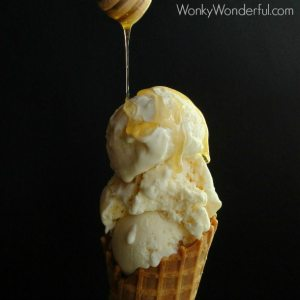 honey being drizzled over creamy ice cream in waffle cone