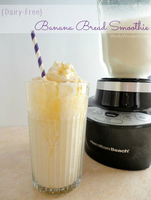 clear glass filled with beige smoothie, blender in the background - text: dairy free banana bread smoothie