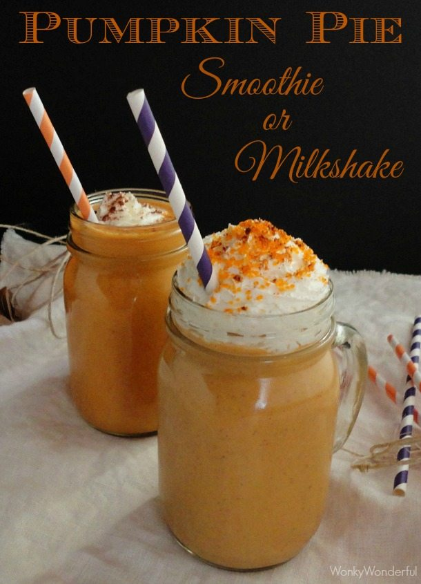 two mason jar glasses filled with orange colored drinks and whipped cream - text: pumpkin pie smoothie or milkshake