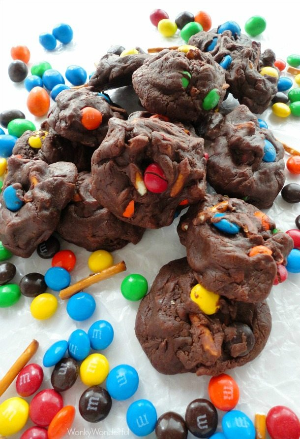 pile of dark brown cookies surrounded by candy