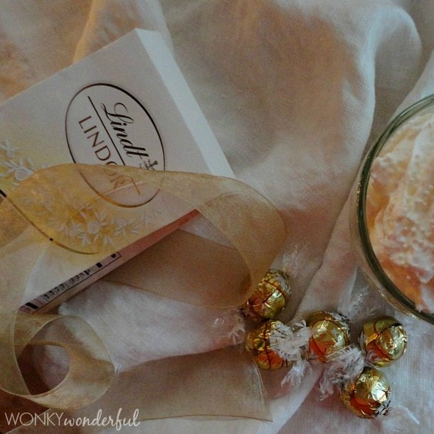 gold wrapped truffles next to Lindt package