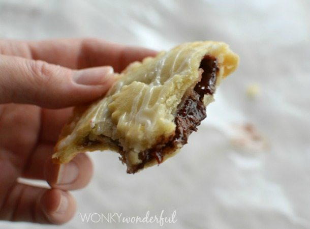 hand holding half eaten mini hand pie