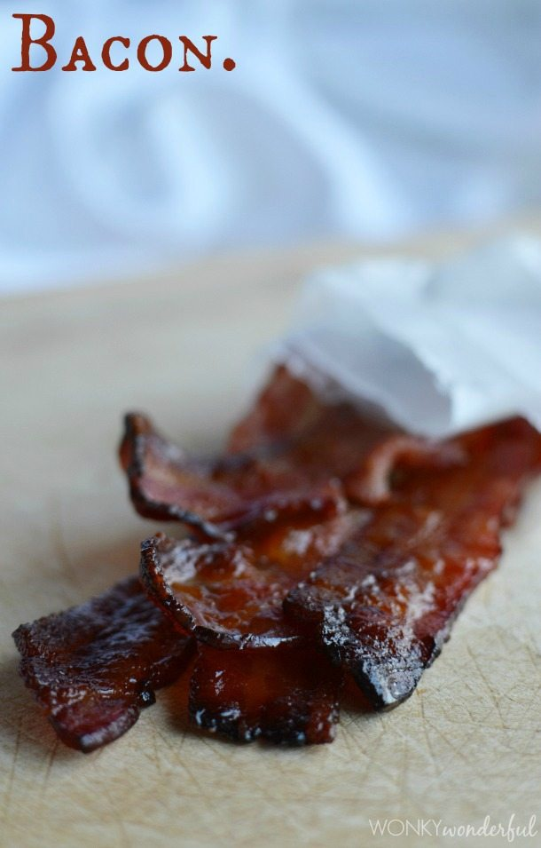 dark brown slices of bacon on cutting board - photo text: bacon.