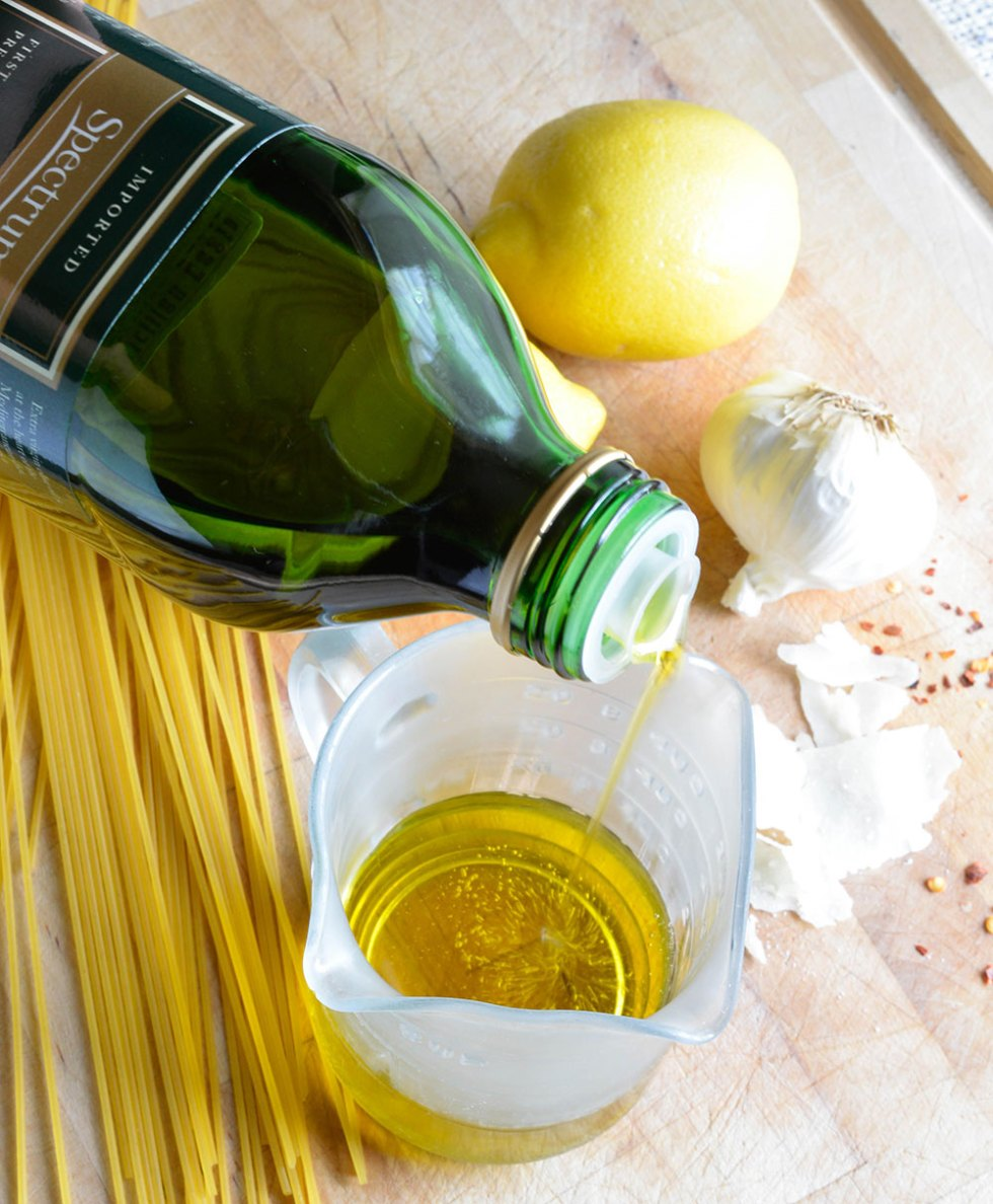 Lemon Garlic Pasta Recipe - A simple dinner idea or filling side dish. Pasta tossed with lemon, premium olive oil, red pepper flakes, parmesan cheese and roasted garlic.