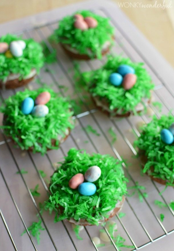 coconut and candy decorated donuts on wire cooling rack
