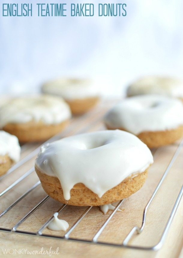 tan donut topped with thick white glaze on wire cooling rack - photo text: English teatime baked donuts
