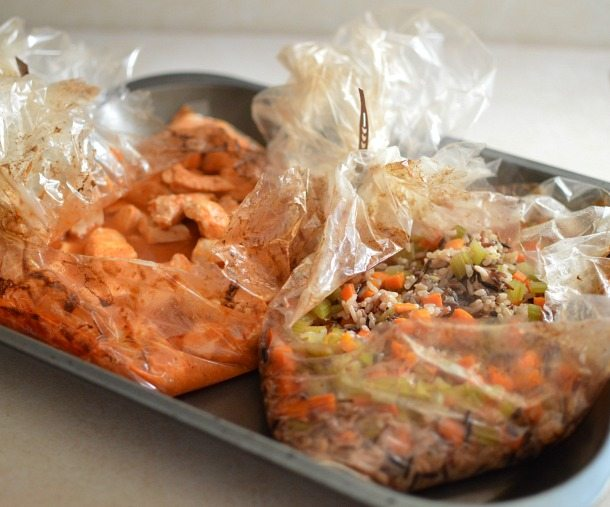 plastic bags cut open to reveal cooked meal