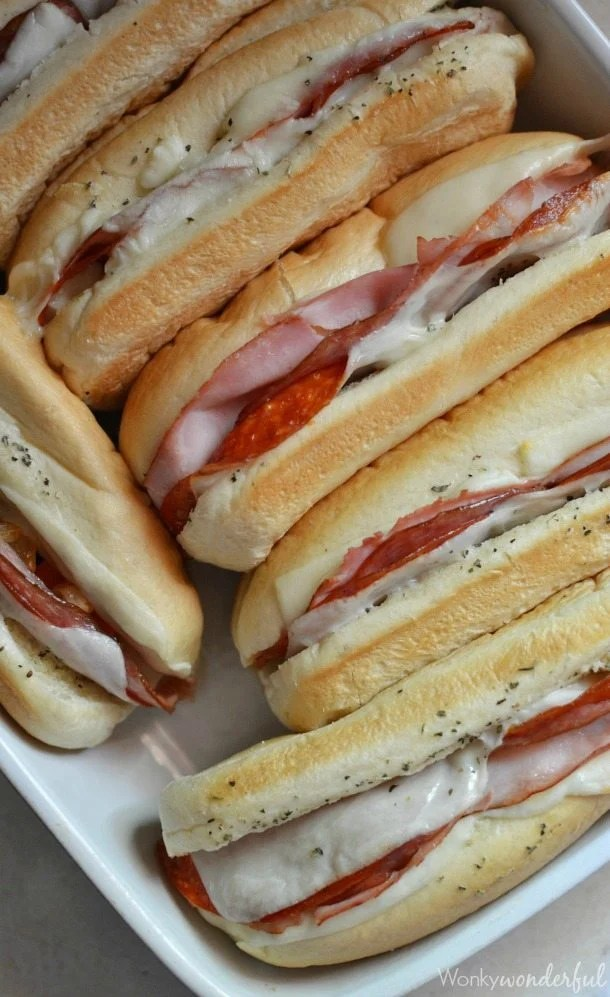 italian sandwiches in roasting dish with melty cheese