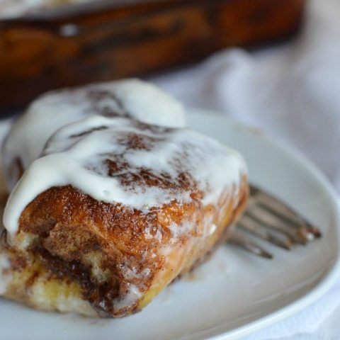 cinnamon roll topped with cream cheese glaze