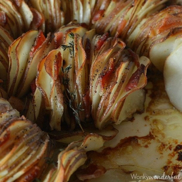 Roasted Potato Side Dish Recipe made with Roasted Garlic, Bacon, Thyme and Red Potatoes. Perfect for your holiday menu!