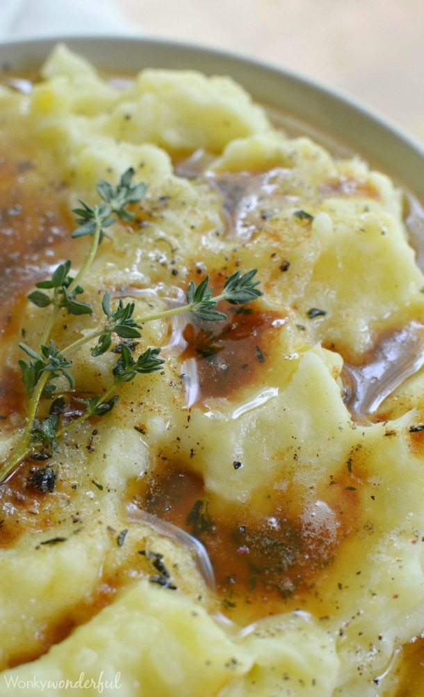Best Mashed Potatoes Recipe - Creamy mashed potatoes with thyme infused brown butter. A super easy yet impressive side dish that is perfect for the holidays!