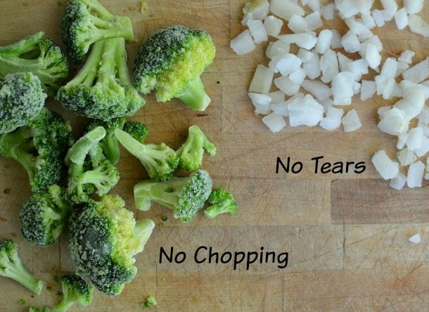 frozen broccoli and frozen chopped onions on wood cutting board