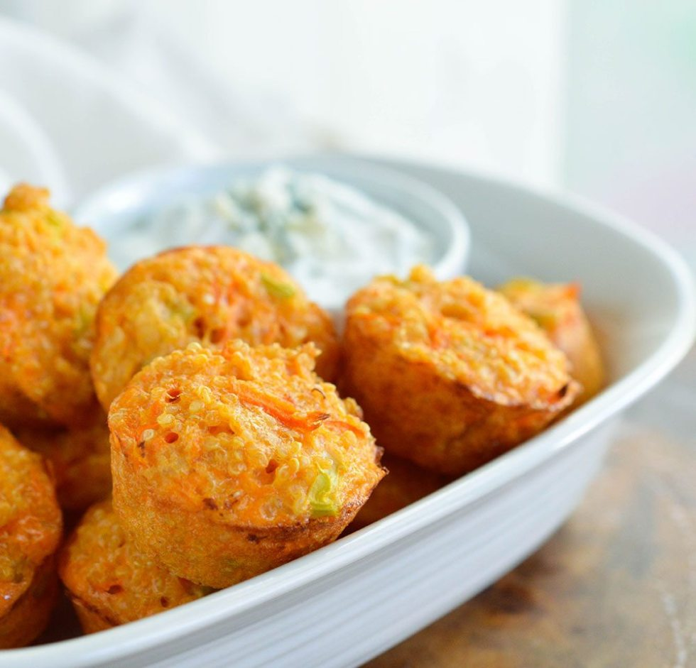 Quinoa Buffalo Bites have all the flavor of buffalo wings but are low fat and low calorie. This gluten free appetizer recipe is perfect for game day or parties! Baked quinoa bites with blue cheese Greek yogurt dipping sauce.