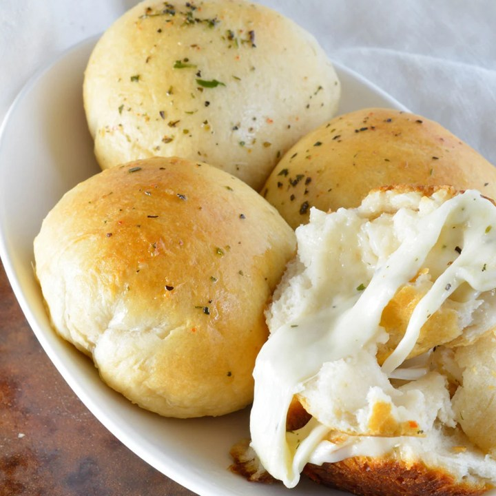 2 Ingredient Cheese Biscuits Recipe - The cheesy rolls are made easy with store bought refrigerated biscuits and herb marinated mozzarella cheese! A quick and easy side dish or appetizer!
