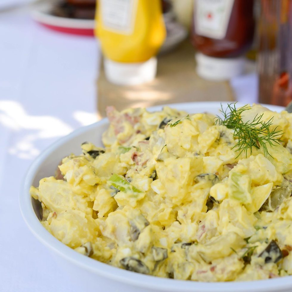 Enjoy this Classic Potato Salad Recipe at your next family barbeque. A creamy traditional potato salad that is the ultimate summertime comfort food!