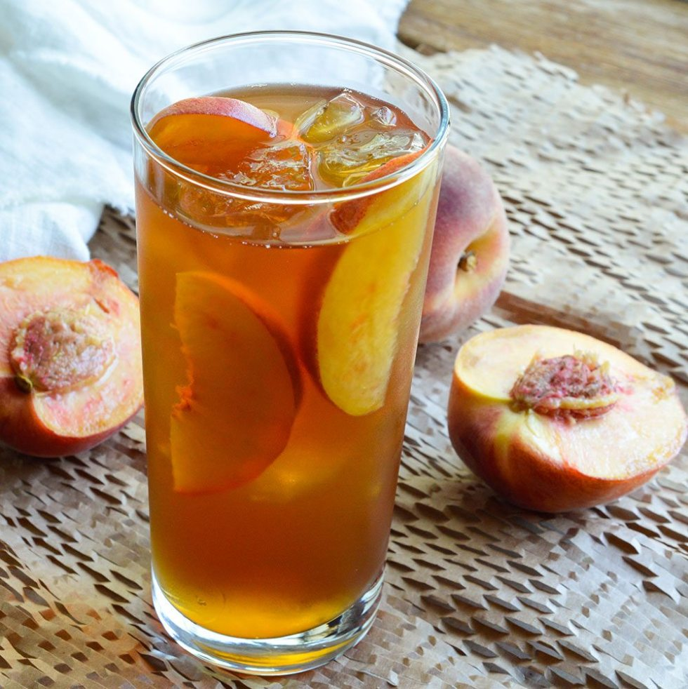 Peach Iced Tea Recipe - This sun tea is infused with fresh ripe peaches and honey. A refreshing and natural summertime beverage!
