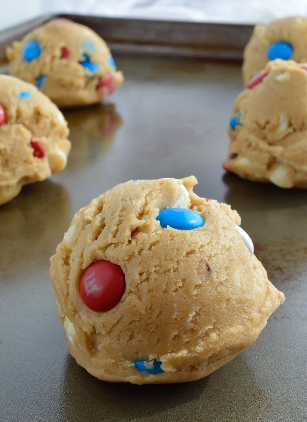 Soft Chocolate Chip Cookies Recipe with M&M's and white chocolate chips. These soft batch cookies are moist, chewy and loaded with Red White and Blue M&M's!