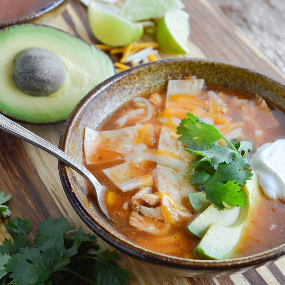This Chicken Tortilla Soup Recipe is an easy 30 minute meal! This soup is perfect for your weeknight dinner menu!