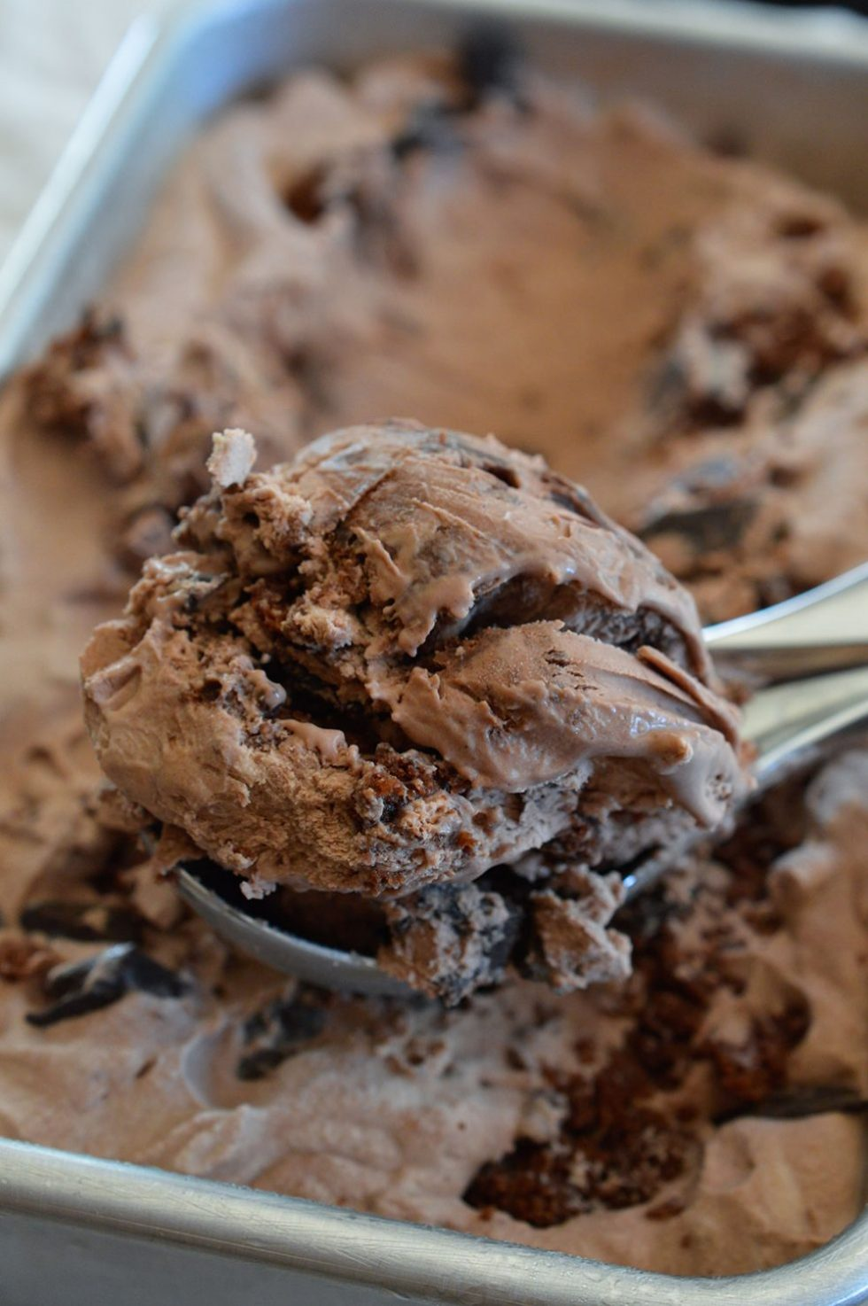 Extreme Chocolate Ice Cream is a must make recipe. This No Churn Ice Cream is packed with Chocolate Chunks and Brownies! Inspired by my favorite Dairy Queen Blizzard flavor. Death By Chocolate never tasted so good!
