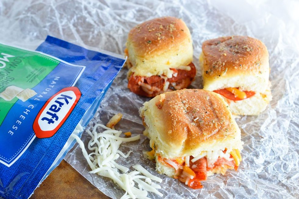 These Oven Baked Pepperoni Pizza Sandwiches are the perfect game day recipe! Quick, easy and guaranteed to be a crowd favorite!