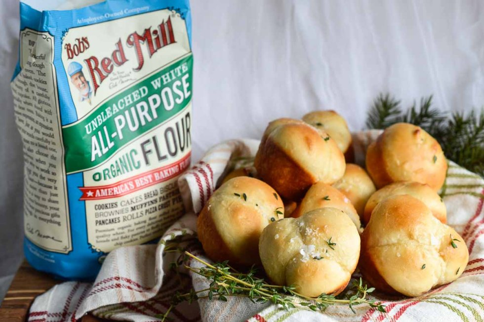These Easy Yeast Rolls are a great addition to any feast! Perfectly sized rolls, baked in muffin tins then slathered with butter and fresh thyme. Nothing beats fresh baked bread!