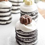 For the perfect Thanksgiving dessert make these Chocolate Pumpkin Spice Ice Box Cakes with wafers and whipped cream. This easy, make ahead recipe will be a holiday hit!