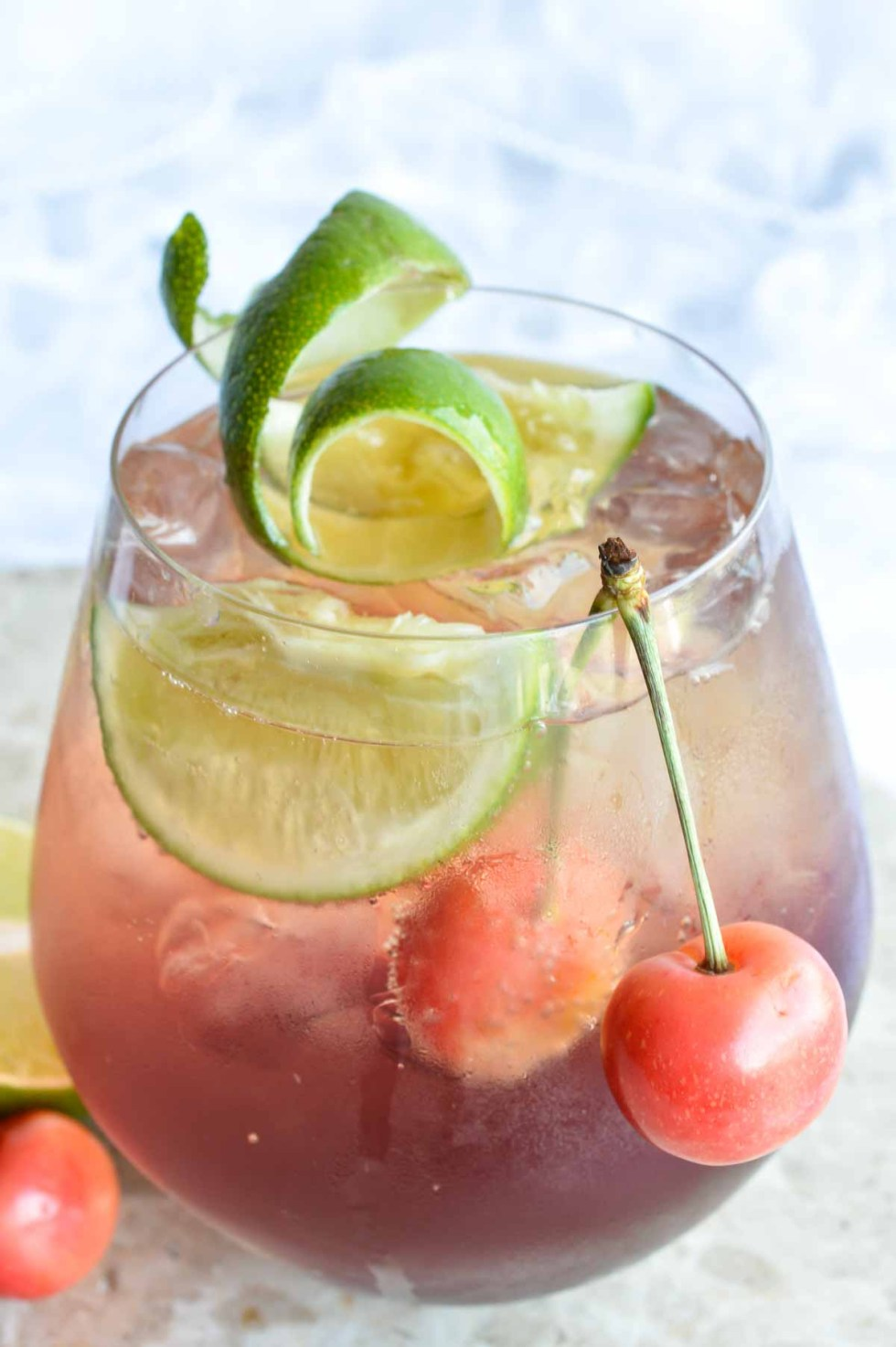 This Shirley Temple Cocktail Recipe is an easy and refreshing party drink. Also known as a Dirty Shirley; a blend of cherry, lime, rum or vodka and fizzy sparkling Dasani.