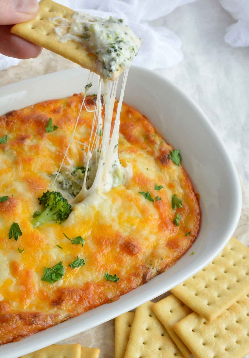 This Broccoli Cheese Dip Recipe is an easy and unique appetizer. Perfect for parties, holiday feasts and game day grub!