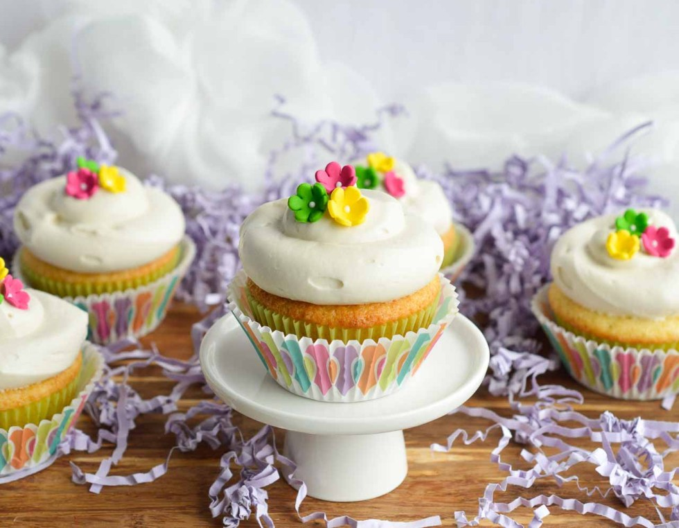 This Vanilla Cream Cheese Frosting Recipe is perfect for just about any cake. Cream cheese whipped into buttercream icing and flavored with vanilla. Make these Spring cupcakes for a tasty Easter treat!