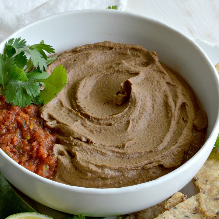 If you are looking for a new twist on boring old bean dip, try this Chipotle Black Bean Dip Recipe! Black beans, chipotle, adobo and lime blended to make this fantastic homemade cold dip. The perfect summertime snack!