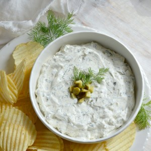You NEED to try this Dill Pickle Dip recipe! Forget about french onion dip. This dip appetizer will be a new crowd favorite! This creamy dip is full of fresh dill and tangy pickles. Look Out! You may eat the entire bowlful!