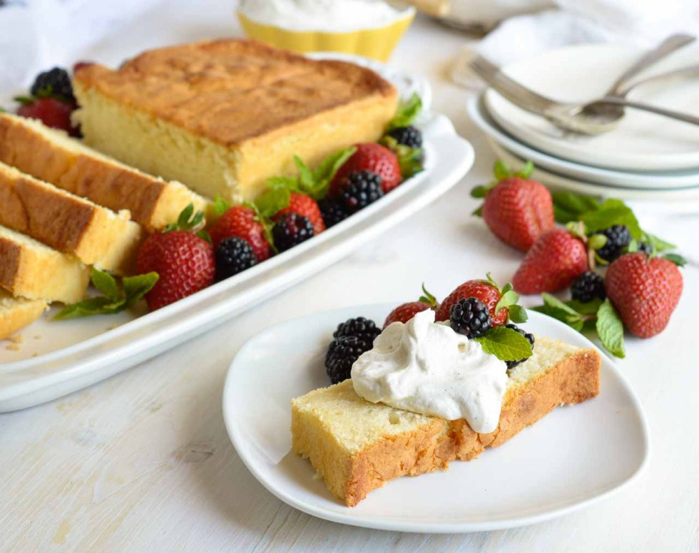Make this Amaretto Pound Cake Recipe with Whipped Crème Fraîche for a simple and indulgent dessert. This easy homemade cake is flavored with almond and amaretto then baked in a loaf pan. Serve with fluffy whipped vanilla crème fraîche and fresh berries for a gorgeous sweet treat!