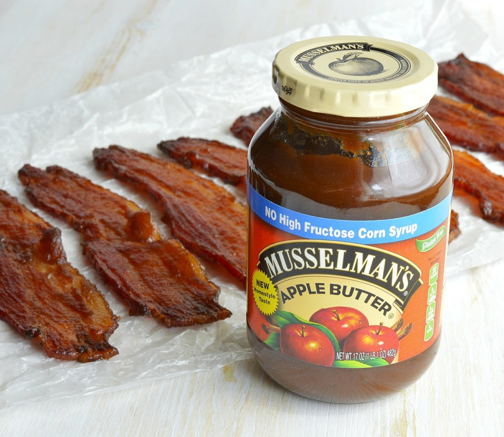 This Candied Bacon Recipe should be illegal. It IS that good! Glazed bacon that is sweet, salty, crispy and super addictive. This apple butter glazed bacon is perfect for any meal or occasion!