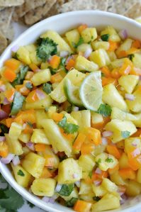 If you want a fresh and fruity summer snack, make this Pineapple Salsa Recipe! It just takes a few simple ingredients and about 5 minutes to make this tasty appetizer. Perfect for summertime parties and backyard barbecues!