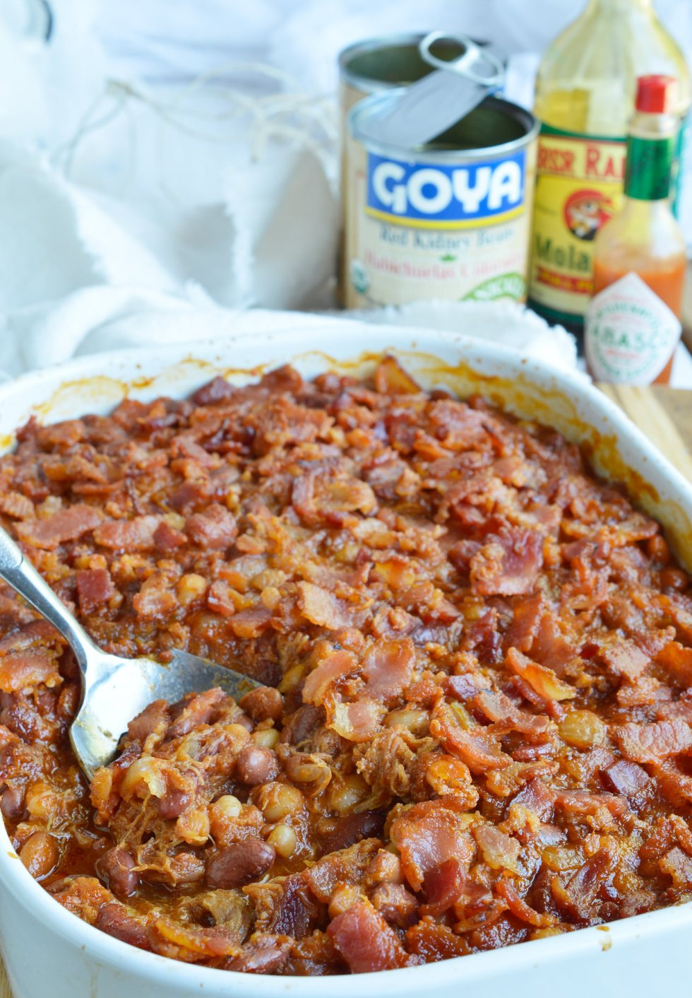 The pulled pork and bacon in this Double Pork Baked Beans Recipe makes it perfect as a side dish or dinner! Homemade pork and beans is super easy and delicious. This dish is great for feeding a hungry crowd!