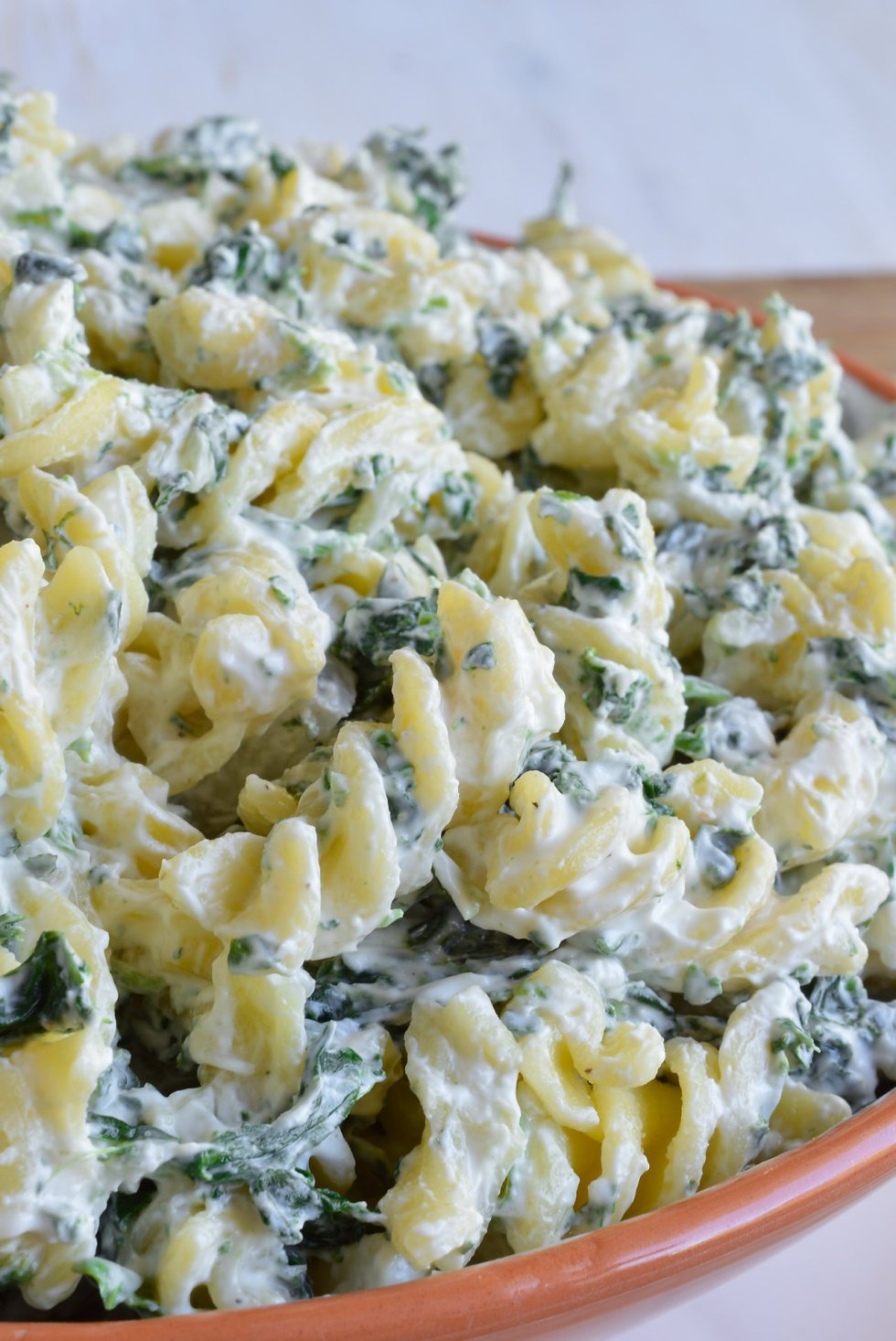 Gluten Free Pasta Salad is not only possible but delicious! This pasta salad recipe has all of the flavors of spinach dip in one great side dish.
