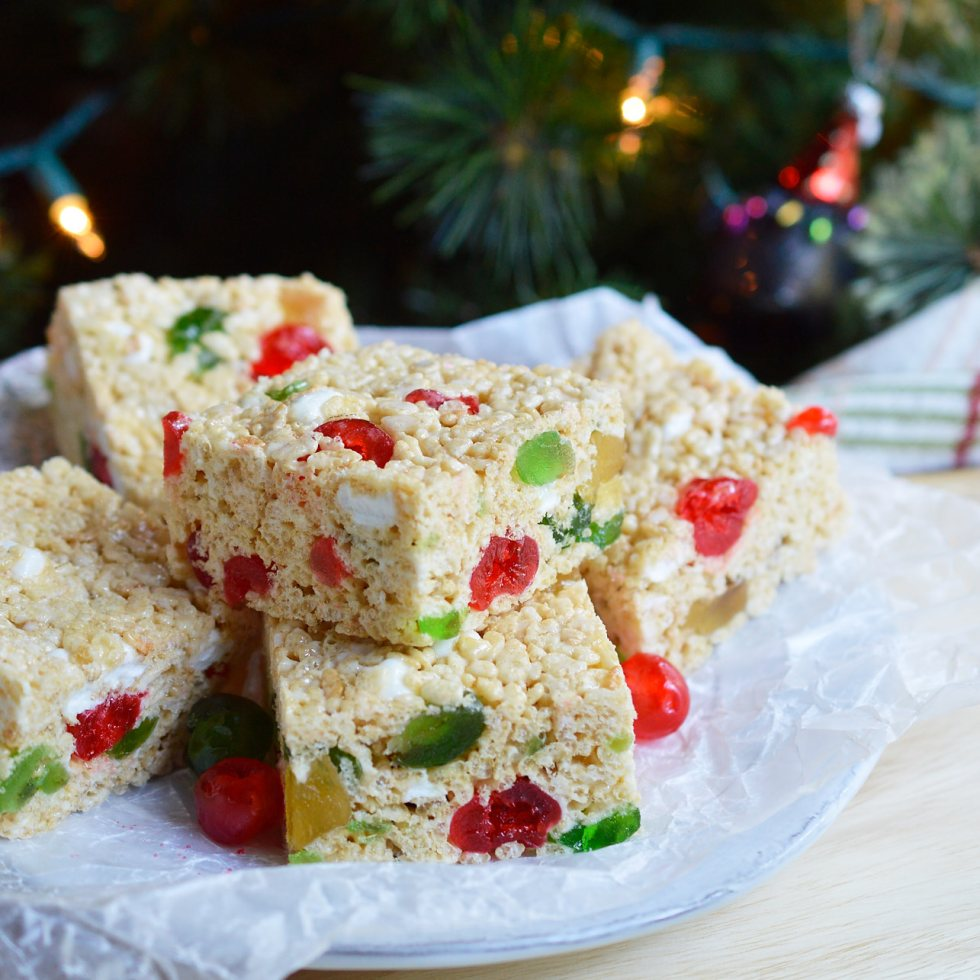 These Holiday Jeweled Krispy Treats are great for a last minute Christmas or New Year's dessert. This crispy treat recipe is inspired by fruit cake with a hint of rum flavor and colorful candied fruit!