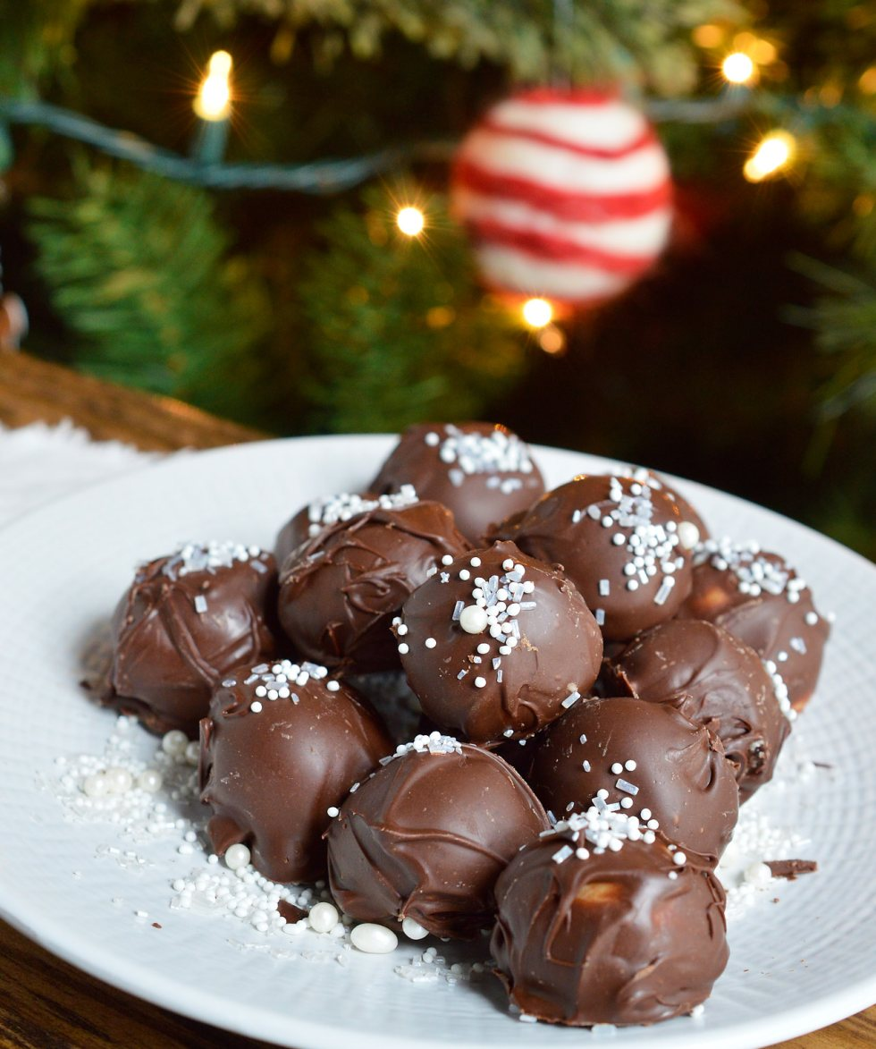 It's time for holiday treat platters and homemade gifts. These Peppermint Pattie Chocolate Truffles will be the star of any Christmas dessert tray! Cool peppermint filling is shaped into balls and coated with chocolate then topped with sprinkles.