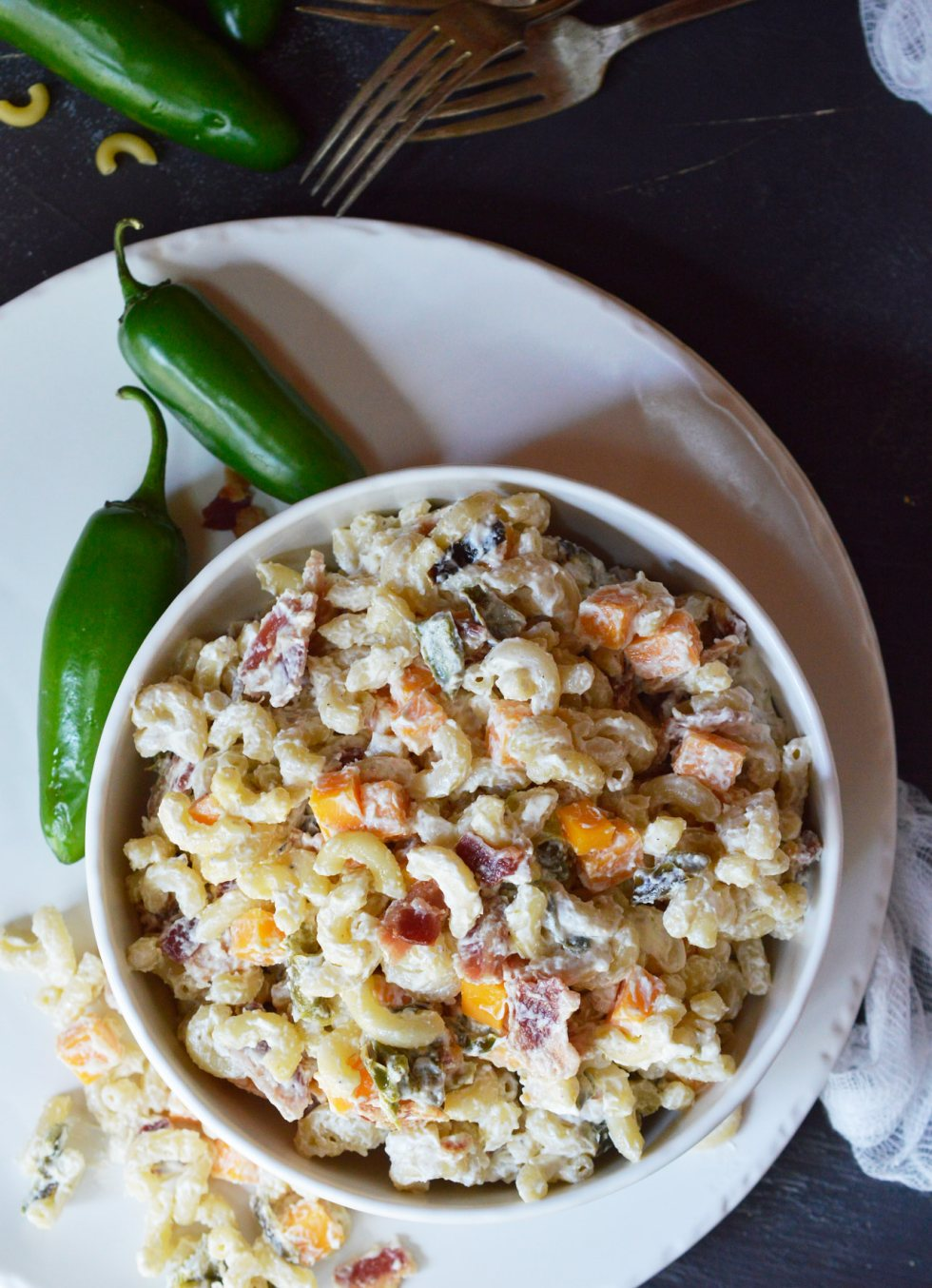 Just in time for barbecue season, this Jalapeño Popper Macaroni Salad Recipe makes a fantastic side dish! Your favorite pasta salad made with cheddar, bacon and roasted jalapeños for a fun twist. Pack it up in your branded Koozie® Grocery Tote Kooler and take the family on a picnic.