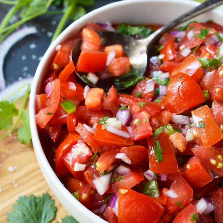 Start the summer off right with Fresh Homemade Pico de Gallo Recipe that is spiked with Altos Plata Tequila. Perfect for a party appetizer or a tasty snack by the pool!