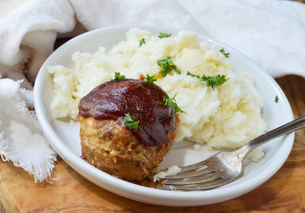 Make your favorite comfort food into individual portions with this Glazed Meatloaf Muffins Recipe! These juicy meatloaves are super flavorful and topped with a sweet, tangy glaze. This easy dinner recipe is sure to be a new family favorite!
