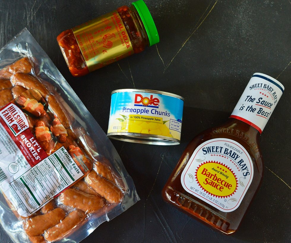 Do you need a quick and easy appetizer for the holidays or game day? This Spicy Pineapple Stovetop Little Smokies Recipe takes just 4 ingredients and is ready in less than 30 minutes! You will actually get to enjoy time with family and friends thanks to this sweet and spicy sausage recipe!