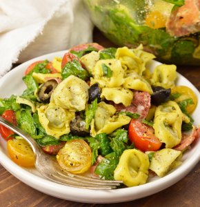 Prepare to be obsessed! This Spinach Tortellini Italian Pasta Salad Recipe is bursting with color, flavor and is nutritious. A perfect blend of fresh spinach, tomatoes, olives, artichokes, salami and tortellini tossed with an Italian dressing. This side dish can be served hot or cold and be prepared ahead of time.