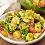 Prepare to be obsessed! ThisSpinach Tortellini Italian Pasta Salad Recipe is bursting with color, flavor and is nutritious. A perfect blend of fresh spinach, tomatoes, olives, artichokes, salami and tortellini tossed with an Italian dressing. This side dish can be served hot or cold and be prepared ahead of time.