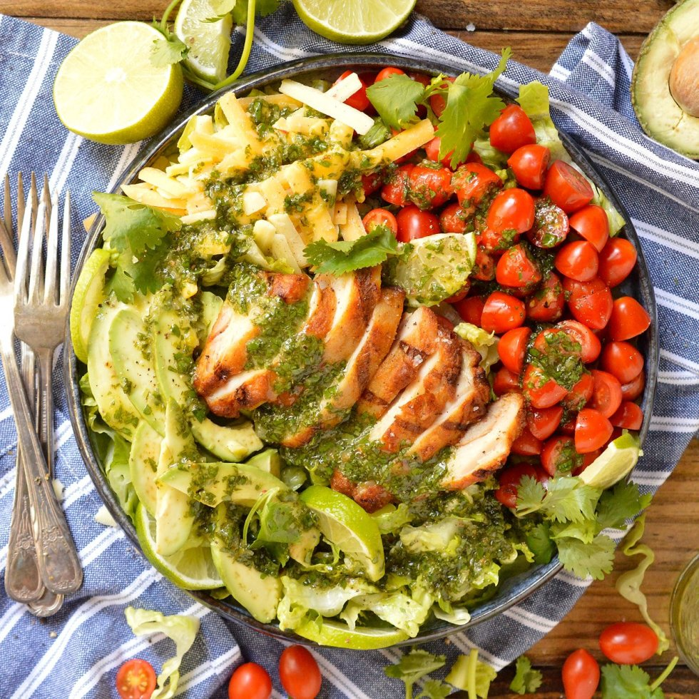 For a quick, fresh, easy and nutritious meal look no further than this Grilled Chicken Salad with Cilantro Lime Dressing. Romaine lettuce topped with tomatoes, avocado, cheese, grilled chicken and cilantro lime vinaigrette... this is an easy dinner recipe that you can feel good about!