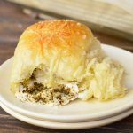 These Pesto Mozzarella Stuffed Yeast Rolls are not only great for a holiday recipe, they are fantastic year round! You can't go wrong with fresh mozzarella and flavorful basil pesto tucked inside these super soft yeast dinner rolls!