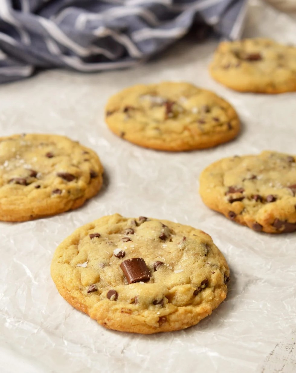 TheseSoft Chocolate Chip Cookies are my family's favorite treat! A special secret ingredient gives them a unique flavor and they are loaded with two types of chocolate chips! Also, this is a High AltitudeChocolate Chip Cookies Recipe. Soft, chewy, super-chocolaty and finished with a sprinkle of sea salt. #chocolatechipcookies #chocolatechipcookierecipes