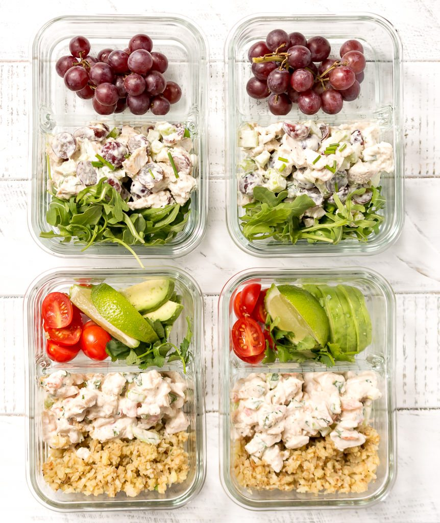 overhead photo of 4 glass meal prep containers filled with chicken salad