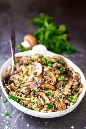 mushroom cauliflower rice in white bowl with spoon